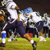 WIndow Rock QB Tyrell Boyd, 4, hands off to Jason Yazzie. Yazzie did not get a clean handoff and dropped the football for a fumble resulting in a turnover. Wingate High School faced off against Window Rock High School at home in Fort Wingate, NM.