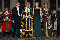 © Licensed to London News Pictures. 13/11/2017. London, UK.  PHILIP MAY, Lord Mayor CHARLES BOWMAN, British Prime Minister THERESA MAY and SAMANTHA BOWMAN attend the annual Lord Mayor's Banquet at Guildhall. Photo credit: Ray Tang/LNP