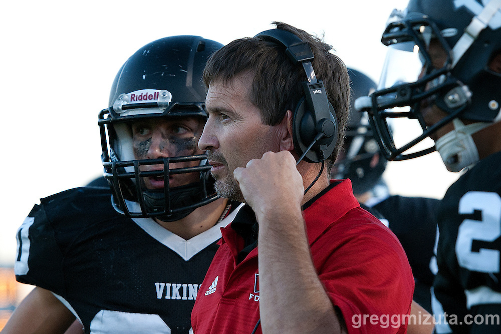 Austin Amick and coach Jeff Jacobs. Vale - Burns football game, September 18, 2015 at Vale High School, Vale, Oregon. Vale won 65-28.