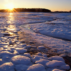 Ice patterns.  Sunrise.  New Hampshire seacoast.  Odiorne Point State Park, Rye, NH