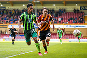 AFC Wimbledon forward Lyle Taylor (33) gets in behind Bradford City defender Anthony McMahon (29)  during the EFL Sky Bet League 1 match between Bradford City and AFC Wimbledon at the Coral Windows Stadium, Bradford, England on 22 April 2017. Photo by Simon Davies.
