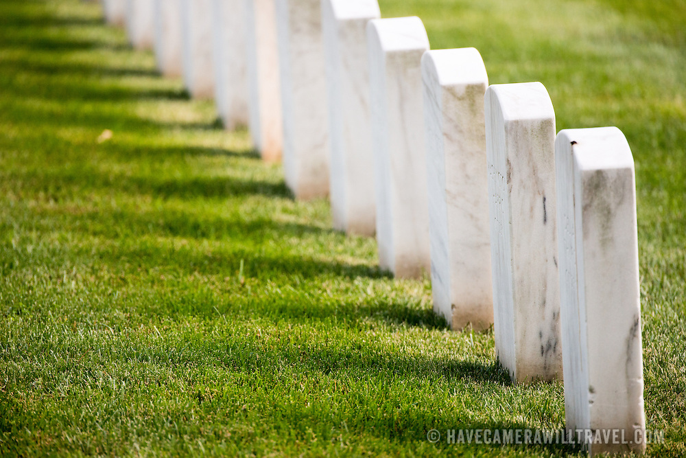 A row of distinctive white headstones at the military cemetery of Arlington National Cemetery on the banks of the Potomac River across the Washington DC.
