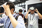An attendee tries out a virtual reality VR headset at the Mobile World Congress Shanghai in Shanghai, China, on Wednesday, June 29, 2016.
