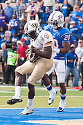 Dec 1, 2012; Tulsa, Ok, USA; University of Central Florida Knights wide receiver Quincy McDuffie (14) pulls down a catch over Tulsa Hurricanes defensive back Demarco Nelson (20) during a game at Skelly Field at H.A. Chapman Stadium. Tulsa defeated UCF 33-27 in overtime to win the CUSA Championship. Mandatory Credit: Beth Hall-USA TODAY Sports