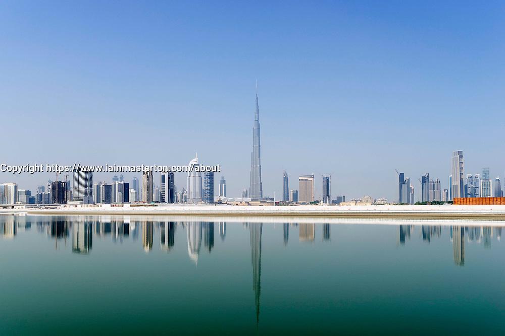 View across The Creek towards skyline of Dubai and Burj Khalifa at Business Bay in United Arab Emirates