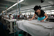 Garment workers operate on the factory floor of the Ever-Glory International Group, Inc., in Nanjing, Jiangsu Province, China on 29 September 2009. China is at an economic cross-road as it can no long rely on an endless supply of cheap labor and streams of export orders from the west, and the government has been attempting to boost domestic consumption with mixed results.
