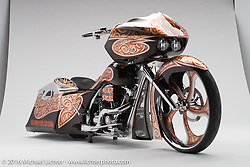 """""""Upper Big Branch Miner Memorial"""", an orange and silver bagger built from a 2009 Harley-Davidson Road Glide by Shannon Davidson of The Chopp Shop in Taylorsville, NC and owned by Tommy Davis. Photographed by Michael Lichter during the Easyriders Bike Show in Columbus, OH on February 19, 2016. ©2016 Michael Lichter."""