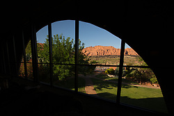 United States, Utah, Ivins, Red Mountain Resort, meditation lounge in spa with view through curved window of red rock canyon. PR