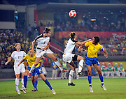 Beijing, CHINA.   Olympic Football, Women's Gold  Medal Game, USA vs BRA.,left to right. in the air, 11. Ali KRIEGER, Kelly O'HARA,  Brazils No.4 TANIA attacks the crossed ball, during the gold medal game at the Beijing Workers Stadium. Thursday,  21.08.2008 [Mandatory Credit: Peter SPURRIER, Intersport Images]
