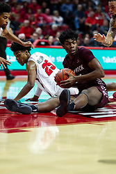NORMAL, IL - November 10: Kamani Johnson gets a loose ball on the floor also sought after by Jaycee Hillsman during a college basketball game between the ISU Redbirds and the Little Rock Trojans on November 10 2019 at Redbird Arena in Normal, IL. (Photo by Alan Look)