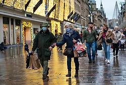 Glasgow, Scotland, UK. 20 November 2020. On the day when the severest level 4 lockdown will be imposed at 6pm, shoppers are out on the streets of Glasgow doing last minute Christmas shopping before the shops close for 3 weeks. Pictured; People shopping on Buchanan Street.   Iain Masterton/Alamy Live News