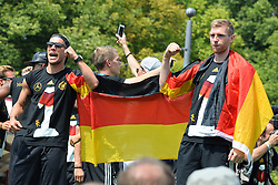 15.07.2014, Brandenburger Tor, Berlin, GER, FIFA WM, Empfang der Weltmeister in Deutschland, Finale, im Bild Lukas Podolski (GER) li. und Per Mertesacker (GER) re. // during Celebration of Team Germany for Champion of the FIFA Worldcup Brazil 2014 at the Brandenburger Tor in Berlin, Germany on 2014/07/15. EXPA Pictures © 2014, PhotoCredit: EXPA/ Eibner-Pressefoto/ Harzer  *****ATTENTION - OUT of GER*****
