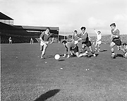 All Ireland Senior Football Championship Final, Kerry v Offaly, 28.09.1969, 09.28.1969, 28th September 1969, Kerry 0-10 Offaly 0-7, 28091969AISFCF, Referee  J Moloney (Tipperary) Captain J Culloty,..B Lynch (Kerry) races in to take advantage of a free ball which has slipped from Offaly defender E Mulligan's grasp,