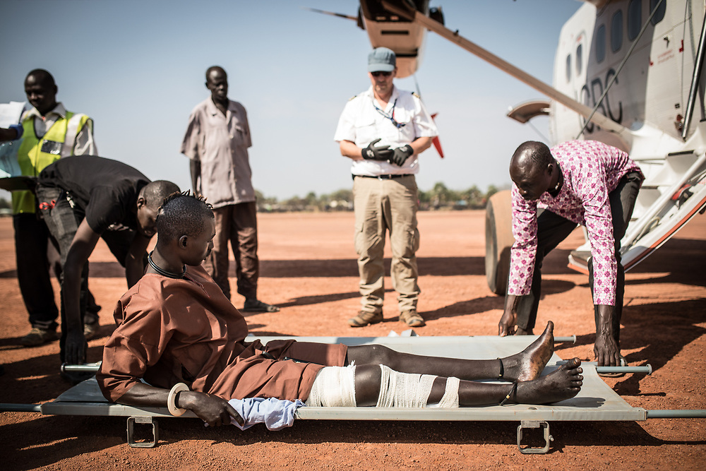 This wounded his about to be evacuated from Rumbek to Juba Military Hospital. Medevacs - together with surgical interventions for weapon-wounded patients - are something the ICRC has carried out for decades - initially from South Sudan to the ICRC hospital in Lopideng in northern Kenya, and since independence to various locations within South Sudan. South Sudan, 2020.
