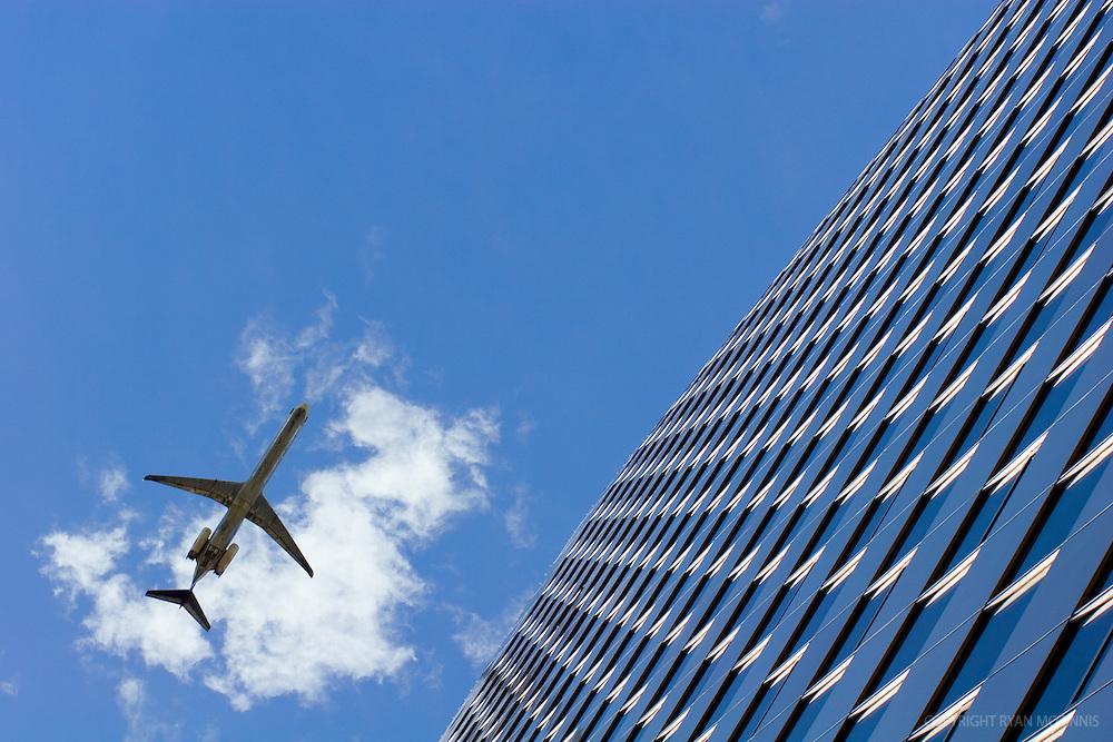 A plane flies over a skyscraper near Washington, D.C., 2006.