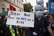London, UK. Saturday, October 17th 2015. Junior doctors protest against new NHS contracts which are set to be imposed by the government, which makes it likely they will have to work even longer hours then they are currently contracted for.