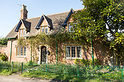 Attractive detached red brick historic house in village of Compton Bassett, Wiltshire, England, UK