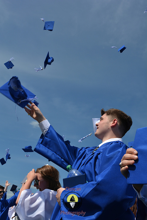 """BATH, Maine --  Austin Lewis throws his hat in the air at conclusion of the Morse High School graduation June 8. he gave the commencement speech.  Besides quoting three U.S. presidents, he said,""""High School wasn't my thing."""" He credited his late grandmother with giving him motivation to finish.  Photo © Roger S. Duncan 2014."""