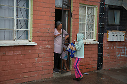 """The kids of a community marshall distribute bread to their neighbours delivered by volunteers to the community of Parkwood, a subburb of Cape Town, located on the Cape Flats, Monday, April 20, 2020. The majority of the people who live here are unemployed during """"normal"""" circumstances. And as South Africa is now in lockdown due to the Coronavirus, many of those who had jobs have also lost their income. So many people are starving. The feeding scheme is a joint community effort, paid for solely by donations from the public to feed more than 3,000 households. The group is also receiving transportation support by The South African Red Cross Society. PHOTO: EVA-LOTTA JANSSON"""