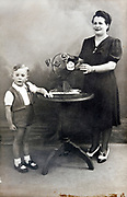 mother with child in studio memory portrait 1940s France