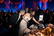 PATRICK COX; ELIZABETH HURLEY; STEPHEN FRY, Grey Goose character and cocktails. The Elton John Aids Foundation Winter Ball. off Nine Elms Lane. London SW8. 30 October 2010. -DO NOT ARCHIVE-© Copyright Photograph by Dafydd Jones. 248 Clapham Rd. London SW9 0PZ. Tel 0207 820 0771. www.dafjones.com.