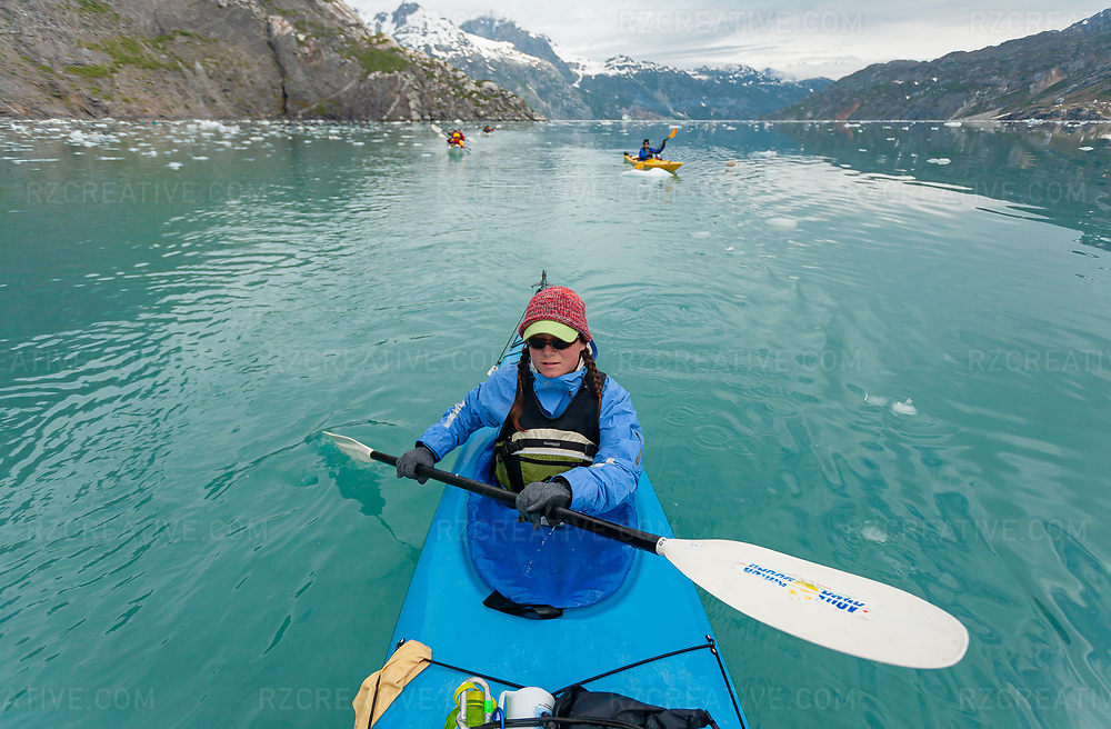 A paddler in Johns Hopkins Inlet in southeast Alaska's Glacier Bay National Park and Preserve. Photo © Robert Zaleski / rzcreative.com<br /> —<br /> To license this image contact: robert@rzcreative.com
