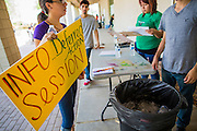"""18 AUGUST 2012 - PHOENIX, AZ: Volunteers set up signs for a deferred action workshop in Phoenix. More than 1000 people attended a series of 90 minute workshops in Phoenix Saturday on the """"deferred action"""" announced by President Obama in June. Under the plan, young people brought to the US without papers, would under certain circumstances, not be subject to deportation. The plan mirrors some aspects the DREAM Act (acronym for Development, Relief, and Education for Alien Minors), that immigration advocates have sought for years. The workshops were sponsored by No DREAM Deferred Coalition.  PHOTO BY JACK KURTZ"""