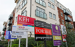 © Licensed to London News Pictures. 14/11/2020.  <br /> Bromley, UK. Estate agents property signs outside a block of flat in Bromley, London. The UK property market is experiencing a mini boom at the moment due to people moving to more rural areas out of London and the reduction to stamp duty which will end in April 2021. Photo credit:Grant Falvey/LNP