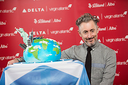 Alan Cumming with the cake, as Delta launching year-round nonstop service from Edinburgh to New York-JFK today at Edinburgh Airport.