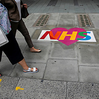 Love NHS pavement sticker art;<br />