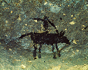 Small black pictograph of horse with rider, likely Apache in origin, Arroyo Segundo, Big Bend Ranch State Natural Area, Texas.