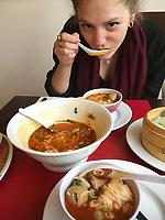 eating Vietnamese Phô Saté soup with beef in an Asian restaurant in Belleville, an Asian neighborhood in Paris