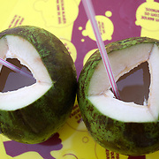 Coconuts are available in abundance and are a popular refreshing natural drink sold along the beaches of Rio de Janeiro throughout the year. Copacabana Beach, Rio de Janeiro,  Brazil. 16th July 2010. Photo Tim Clayton..