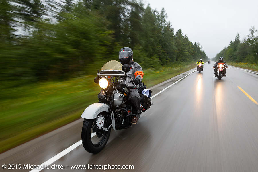Rodney Sterling riding his 1945 Harley-Davidson WL Flathead through the rain during the Cross Country Chase motorcycle endurance run from Sault Sainte Marie, MI to Key West, FL. (for vintage bikes from 1930-1948). Stage 1 from Sault Sainte Marie to Ludington, MI USA. Friday, September 6, 2019. Photography ©2019 Michael Lichter.