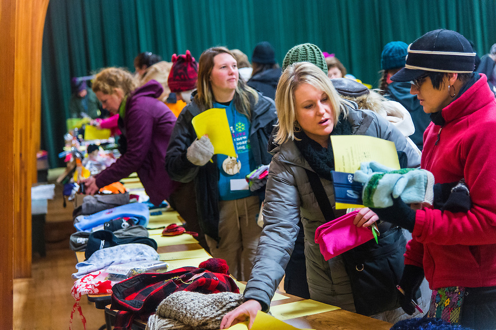 Participants in the Michigan DNR Becoming and Outdoors Woman program browse a silent auction at Bay Cliff Health Camp in Big Bay, Michigan.