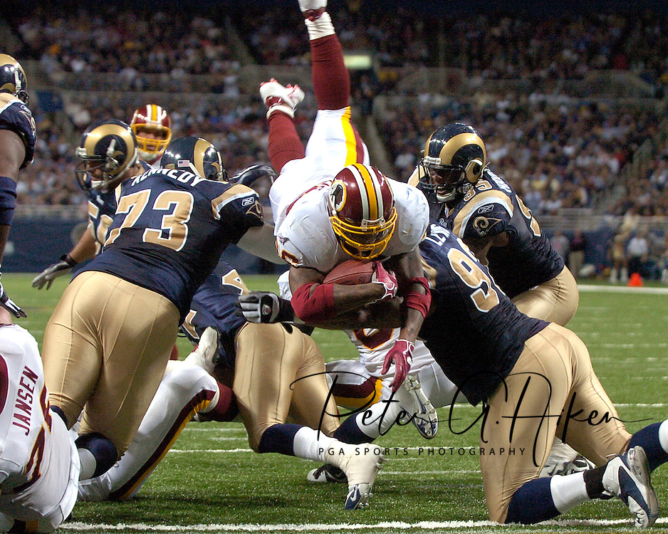 Washington Redskins running back Clinton Portis dives up and over the St. Louis Rams defense for a fourth quarter touchdown, giving Washington a 17-7 lead, during the Redskins 24-9 win at the Edward Jones Dome in St. Louis, Missouri, December 4, 2005.