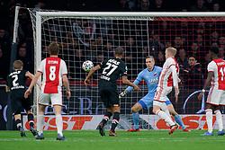 Donny van de Beek #6 of Ajax, Marco Bizot #1 of AZ Alkmaar in action during the Dutch Eredivisie match round 25 between Ajax Amsterdam and AZ Alkmaar at the Johan Cruijff Arena on March 01, 2020 in Amsterdam, Netherlands