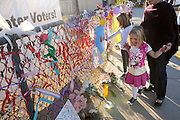 A memorial was created at Mesa Verde Elementary School where student, Christina Taylor Green, 9, was a student.  Green was killed during an assassination attempt on Arizona Congresswoman, Gabrielle Giffords, in Tucson, Arizona, USA, on January 8, 2011.  Heidi Radtke and her daughters, Hannah, 7, (left), and Lauren, 4, pay their respects.