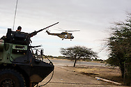 French helicopters take off from the Timbuktu airport after it was secured on Jan. 28, 2013.