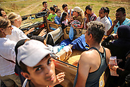 Local residents hand out supplies to migrants and refugees at the Hotel Captain Elias in Kos, Greece on July 1, 2015. The migrants and refugees on the greek island receive little assistance from the greek government and NGOs.