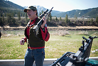 Wyoming Game and Fish biologist Gary Frolic gives a briefing to participants of a mountain goat capture before operations began last week in Alpine.