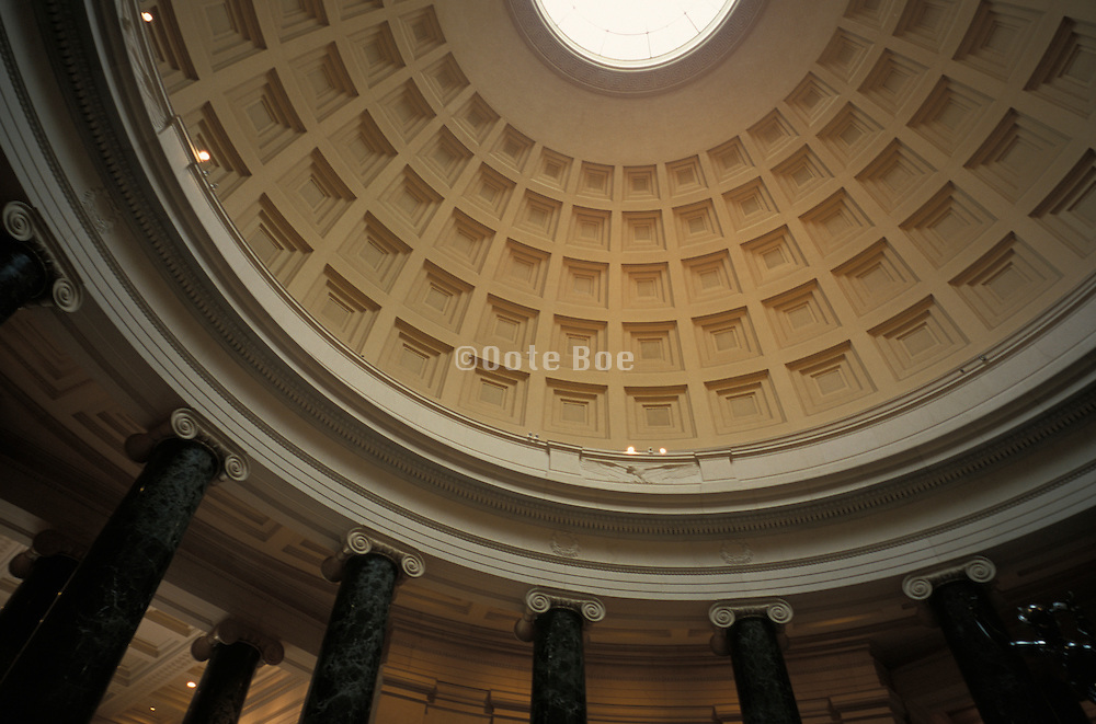 Upward view of a classical domed ceiling