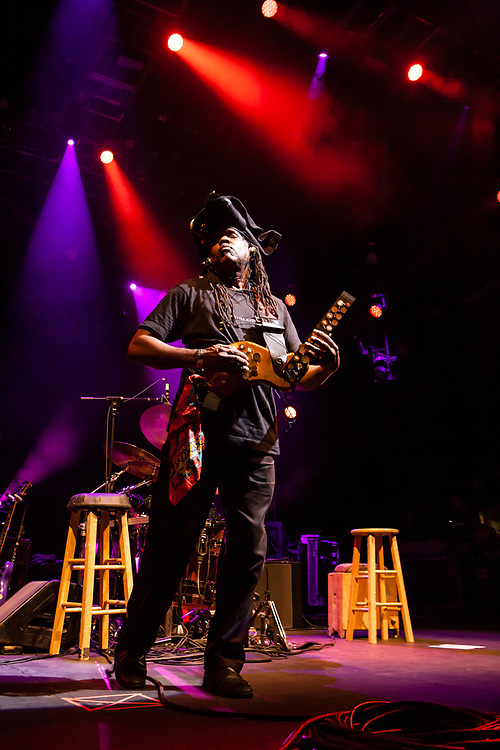 """3 August 2017 – Brooklyn, NY. Singer Nellie McKay opened for Béla Fleck and the Flecktones to a large crowd at the BRIC Celebrate Brooklyn! Festival at the Prospect Park Bandshell. The Flecktones' percussionist Roy """"Future Man"""" Wooten on a drumitar, a keyed drum synthesizer shaped like a guitar."""