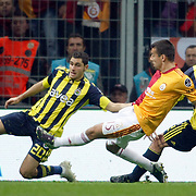 Galatasaray's Milan BAROS (C) and Fenerbahce's Ozer HURMACI (L) during their Turkish superleague soccer derby match Galatasaray between Fenerbahce at the Turk Telekom Arena in Istanbul Turkey on Friday, 18 March 2011. Photo by TURKPIX
