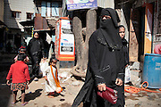 Two muslim women walk the streets of the slum which is predominantly a muslim comunity.  The slum of Cheetah Camp on the outskirts of Mumbai, India is a predominantly muslim community on living on the fringe while the city continues to grow.