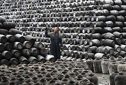 November 21, 2018 - Shaoxing, China - A worker checks the jars used to contain rice wine at Shaoxing Nuerhong Winery Company in Shaoxing, east China's Zhejiang Province. The company maintains its traditional rice wine brewing method, which is composed of nearly 20 processing steps. (Credit Image: © Weng Xinyang/Xinhua via ZUMA Wire)