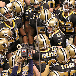 16 January 2010: New Orleans Saints quarterback Drew Brees (9) leads a pre game huddle prior to kickoff of a 45-14 win by the New Orleans Saints over the Arizona Cardinals in a 2010 NFC Divisional Playoff game at the Louisiana Superdome in New Orleans, Louisiana.
