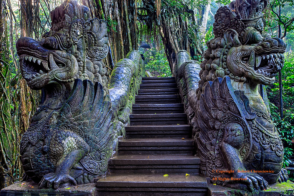 Dragon bridge: Two ferocious dragons stand guard before this walking bridge, found in the heart of the Monkey Forest Park, Ubud Bali Indonesia.
