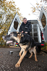 © Licensed to London News Pictures . 13/11/2012 . Manchester , UK . Joe Flood with 7 month old rescue German Shepherd , Archie . Specialist handlers from Greater Manchester Police put police dogs through their paces at a training event . Greater Manchester Police are appealing for members of the public to donate unwanted dogs to the force . Photo credit : Joel Goodman/LNP