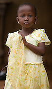 Portrait of young girl in light yellow dress in Tamale, northern Ghana, on Sunday June 3, 2007.